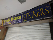 Strikers Spoken English Logo