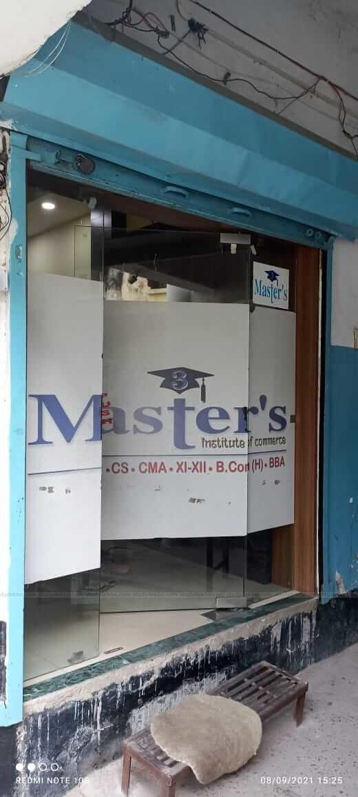 3 Master's Institute of Commerce Logo